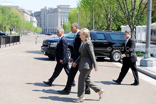 United States President Barack Obama flanked by White House Chief of Staff Rahm Emanuel and U.S. Secretary of State Hillary Rodham Clinton walks from the White House to the Blair House to participate in bilateral meetings Sunday, April 11, 2010 in Washington, DC. .Credit: Olivier Douliery / Pool via CNP