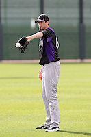 Andrew Johnston of the Colorado Rockies participates in spring training workouts at Salt River Fields on February 26, 2011  in Scottsdale, Arizona. .Photo by:  Bill Mitchell/Four Seam Images.