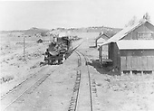 Eastbound D&amp;RGW passenger train pulled by K-36 #488 passing Allison, Colorado.  Metal warehouse in right foreground.<br /> D&amp;RGW  Allison, CO
