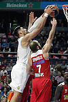 Real Madrid's Gustavo Ayon (l) and Olympimpiacos Piraeus' Vassilis Spanoulis during Euroleague match. January 28,2016. (ALTERPHOTOS/Acero)