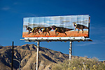 Billboard in desert depicting dinosuars at Cabazon near Palm Springs, California