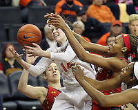 Virginia guard Lexie Gerson (14) reaches for the loose ball during the game Thursday in Charlottesville, VA. Virginia defeated Maryland 86-72. Photo/The Daily Progress/Andrew Shurtleff