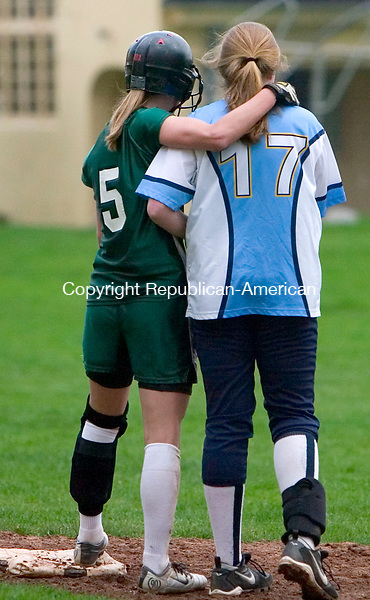 MIDDLEBURY, CT- 28 APRIL 07- 042807JT16-<br /> Westover's Molly Sheehan, right, and Hamden Hill's Alexa DellaRocco chat after a dramatic play between third and home during Saturday's game at Westover.<br /> Josalee Thrift Republican-American