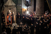 Armenian Orthodox Priests celebrating at the Stone of three women (Armenian Shrine). Jerusalem