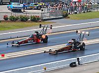 Jun 18, 2017; Bristol, TN, USA; NHRA top fuel driver Mike Salinas (near) races alongside Kebin Kinsley during the Thunder Valley Nationals at Bristol Dragway. Mandatory Credit: Mark J. Rebilas-USA TODAY Sports