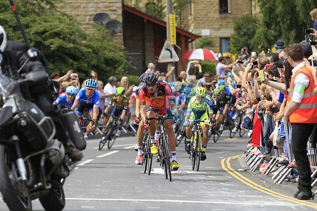 The peleton pass through the outskirts of Halifax during Stage 2 of the 2014 Tour de France running 200km from York to Sheffield. 6th July 2014.<br /> Picture: Eoin Clarke www.newsfile.ie