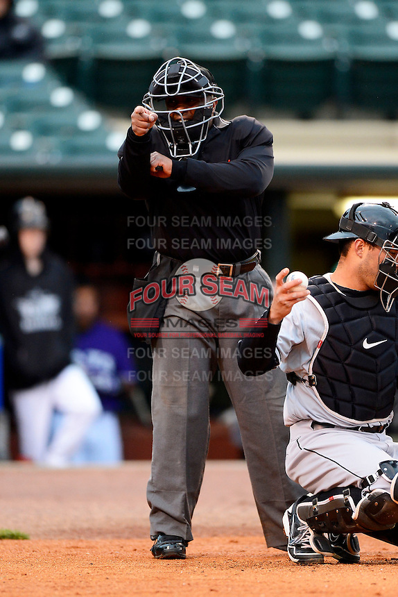 Umpire Kelvin Bultron makes a call during a game between the Louisville Bats and Indianapolis Indians on April 19, 2013 at Louisville Slugger Field in Louisville, Kentucky.  Indianapolis defeated Louisville 4-1.  (Mike Janes/Four Seam Images)