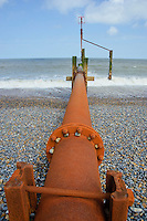 Drain emtying into the sea at Weybourne, Norfolk.