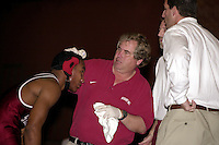 19 January 2001: Trainer Perry Archibald fixes an injured Harold Penson during a wrestling meet against UC Davis at Burnham Pavilion in Stanford, CA.