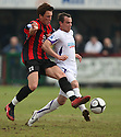 Lee Smith of Histon tackles Luke Moore of Wimbledon during the Blue Square Bet Premier match between Histon and AFC Wimbledon at the Glass World Stadium, Histon on 16th April, 2011.© Kevin Coleman 2011.