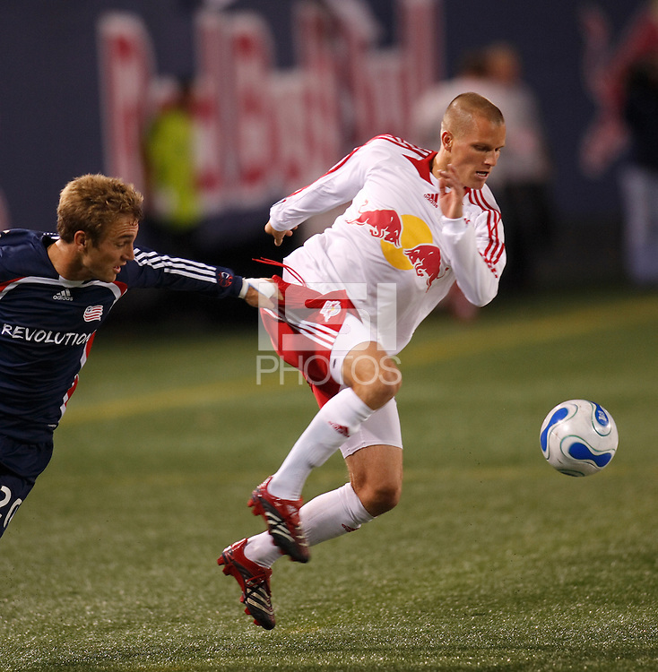 New England Revolution forward (20) Taylor Twellman grabs the shorts of New York Red Bulls defender (6) Seth Stammler. The New York Red Bulls and the New England Revolution played to a 0-0 tie during first leg of the MLS Eastern Conference Semifinal Series at Giants Stadium in East Rutherford, NJ, on October 27, 2007.