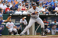 Detroit Tigers shortstop Carlos Guillen takes a strike as Royals catcher Jason LaRue holds his glove for the catch at Kauffman Stadium in Kansas City, Missouri on May 5, 2007.