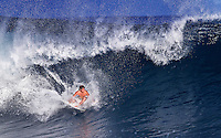 Surfer in the pipe at the Banzai Pipeline on North Shore of Oahu.