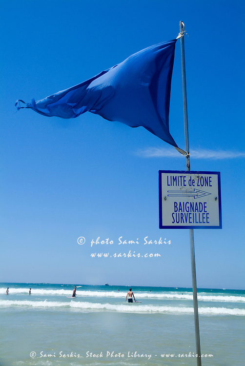 Swimming boundary flag on Biscarrosse Beach, Aquitaine, France.