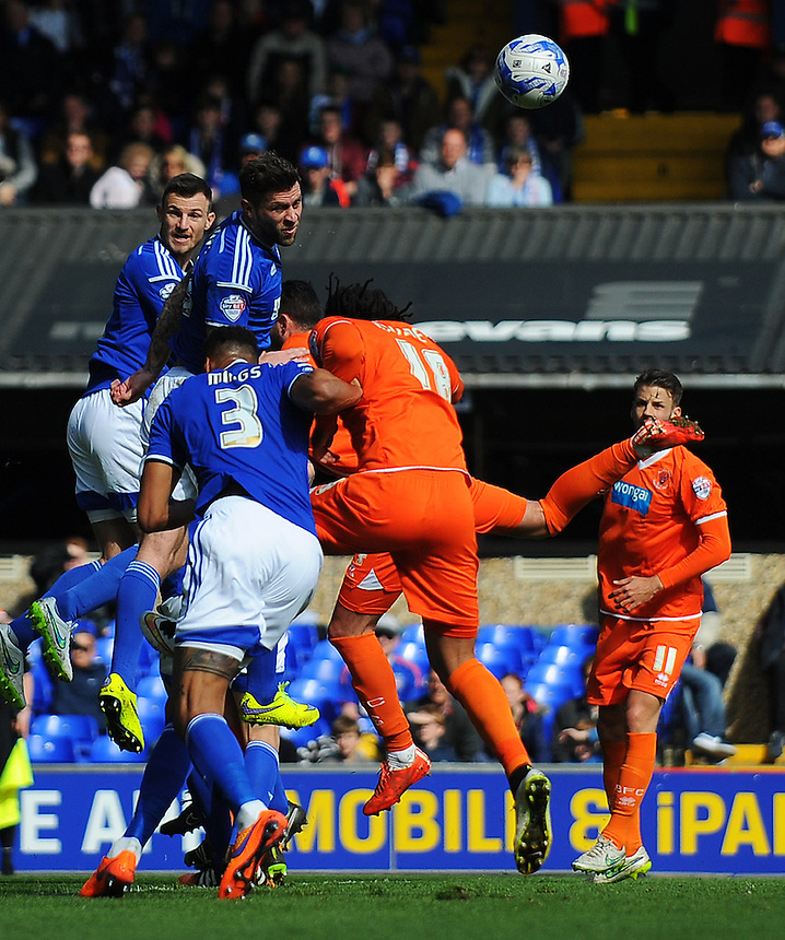 Ipswich Town's Tommy Smith (left) heads clear under pressure from Blackpool's Gary Madine<br /> <br /> Photographer Kevin Barnes/CameraSport<br /> <br /> Football - The Football League Sky Bet Championship - Ipswich Town v  Blackpool - Saturday 11th April 2015 - Portman Road - Ipswich<br /> <br /> &copy; CameraSport - 43 Linden Ave. Countesthorpe. Leicester. England. LE8 5PG - Tel: +44 (0) 116 277 4147 - admin@camerasport.com - www.camerasport.com