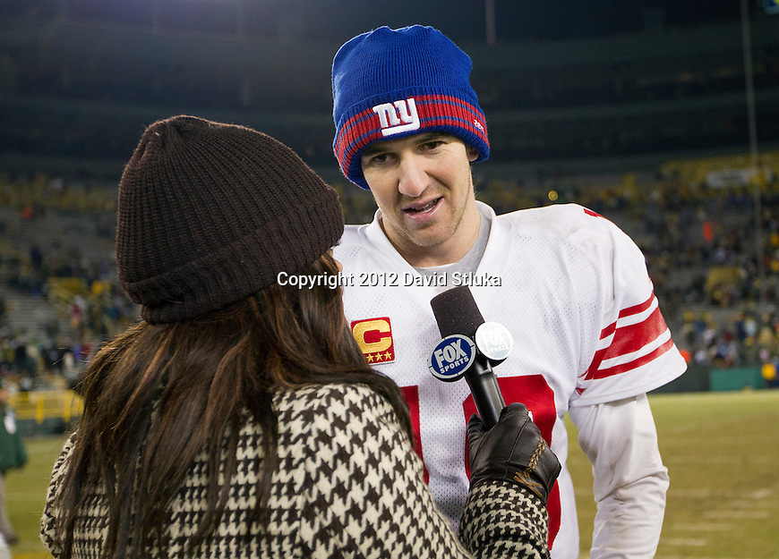 Fox Sports reporter Pam Oliver interviews New York Giants quarterback Eli Manning (10) after an NFL divisional playoff football game against the Green Bay Packers on January 15, 2012 in Green Bay, Wisconsin. The Giants won 37-20. (AP Photo/David Stluka)