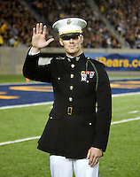 US Marine Lt. Garrett Cross is pictured waving to the fans from the field during a timeout at Memorial Stadium in Berkeley, California on October 6th, 2012.  California defeated UCLA, 43-17.