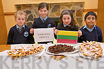 Enjoying food from Lithuania at the Kilcummin National School Food Fair. .L-R Anthony O'Carroll, Ella Kehoe, Cara O'Connell and Jim Healy.