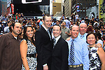 Kevin's family sister Carol, brother Glenn, dad Kevin and mom Christine pose at the wedding of We Love Soaps  Roger Newcomb and Kevin Mulcahy Jr on August 18, 2012 in Times Square, New York City, New York. (Photos by Sue Coflin/Max Photos)