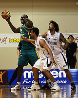 Boomers forward Nathan Jawai directs his teammates as Mika Vukona and BJ Anthony close in during the International basketball match between the NZ Tall Blacks and Australian Boomers at TSB Bank Arena, Wellington, New Zealand on 25 August 2009. Photo: Dave Lintott / lintottphoto.co.nz
