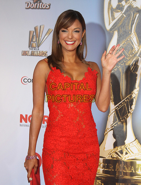 Eva La Rue .at The 2011 NCLR ALMA Awards held at the Santa Monica Civic Auditorium in Santa Monica, California, USA, September 10th 2011.                                                                               .half length red hand waving  lace dress .CAP/RKE/DVS.©DVS/RockinExposures/Capital Pictures.