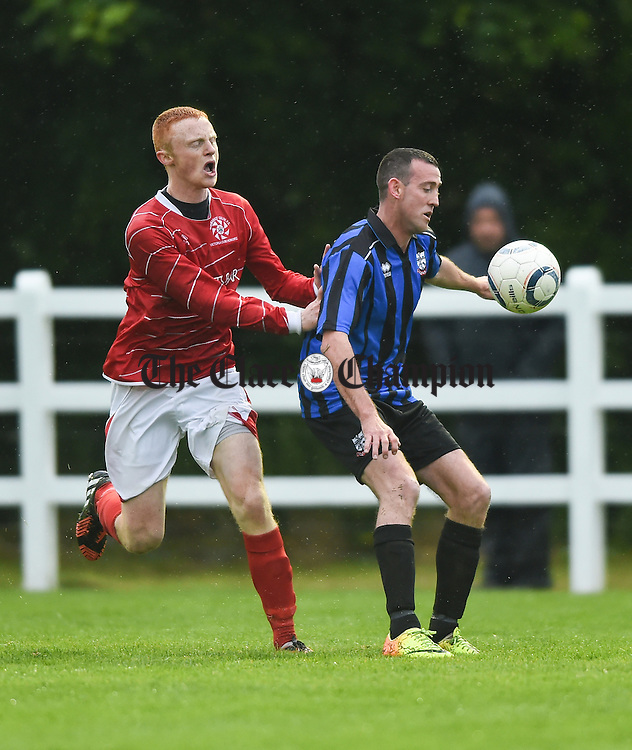 Alan Kelly of Newmarket Celtic in action against Trevor Maxwell of Bridge United during their Cup final at Doora. Photograph by John Kelly.
