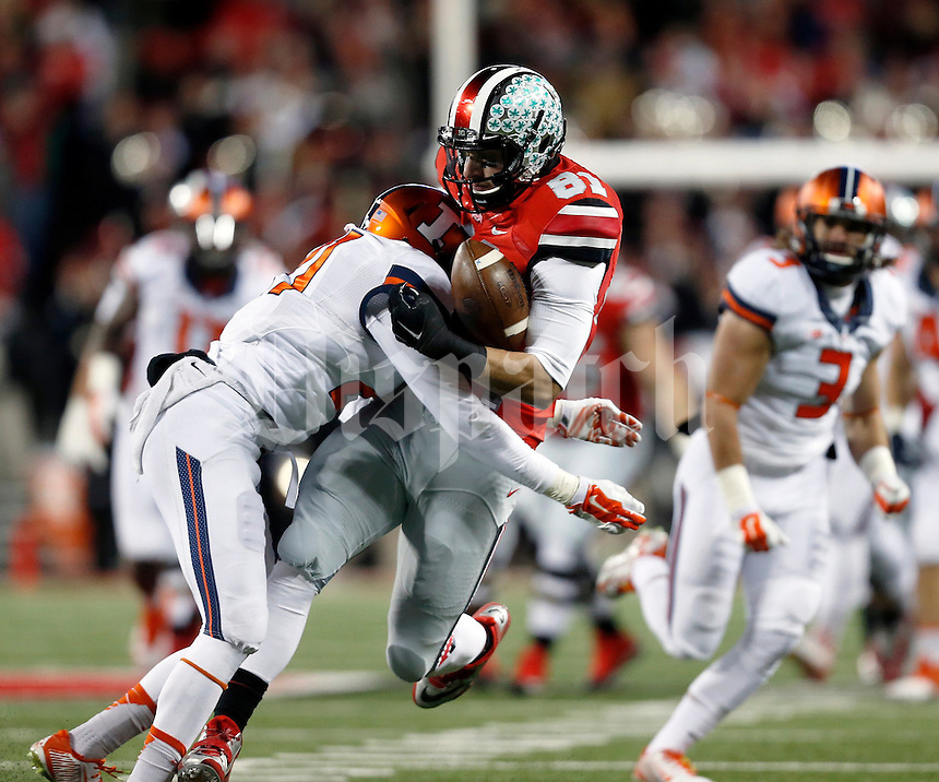 Ohio State Buckeyes tight end Nick Vannett (81) gets the ball knocked away by Illinois Fighting Illini defensive back Zane Petty (21) in the first quarter of the NCAA football game at Ohio Stadium on Saturday, November 1, 2014. (Columbus Dispatch photo by Jonathan Quilter)