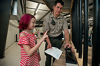 NWA Democrat-Gazette/BEN GOFF @NWABENGOFF<br /> Cpl. Zac Hale shows Tabitha Lantz, 10, of Bella Vista how to make a fingerprint Friday, Aug. 11, 2017, at the Benton County Sheriff's Office table at the Benton County Fair in Bentonville.