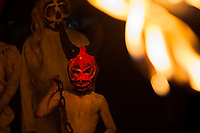 A Salvadoran boy, wearing a horned mask, performs an indigenous mythology character in the La Calabiuza parade at the Day of the Dead festivity in Tonacatepeque, El Salvador, 1 November 2016. The festival, known as La Calabiuza since the 90s of the last century, joins Salvador's pre-Hispanic heritage and the mythological figures (La Sihuanaba, El Cipitío, La Llorona etc.) collected from the whole Central American region, together with the catholic All Saints Day holiday and its tradition of honoring the dead relatives. Children and youths only, dressed up in scary costumes and carrying painted carts, march from the local cemetery to the downtown plaza where the party culminates with music, dance, drinking and eating pumpkin (Ayote) with honey.