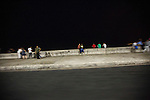 HAVANA, CUBA -- MARCH 25, 2015:   People sit on the seawall along the Malecon in Havana, Cuba on March 25, 2015.  Photograph by Michael Nagle