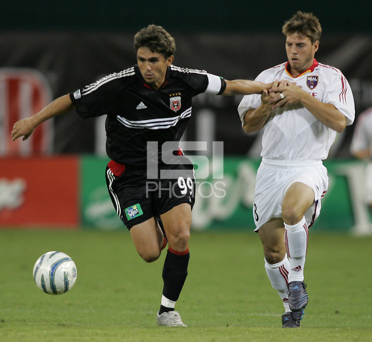 August 31, 2005: Washington, DC, USA:  .DC United forward Jaime Moreno (99) holds off Real Salt Lake midfielder Adolfo Gregario (8) at RFK Stadium  (c) Copyright 2005 Brad Smith.