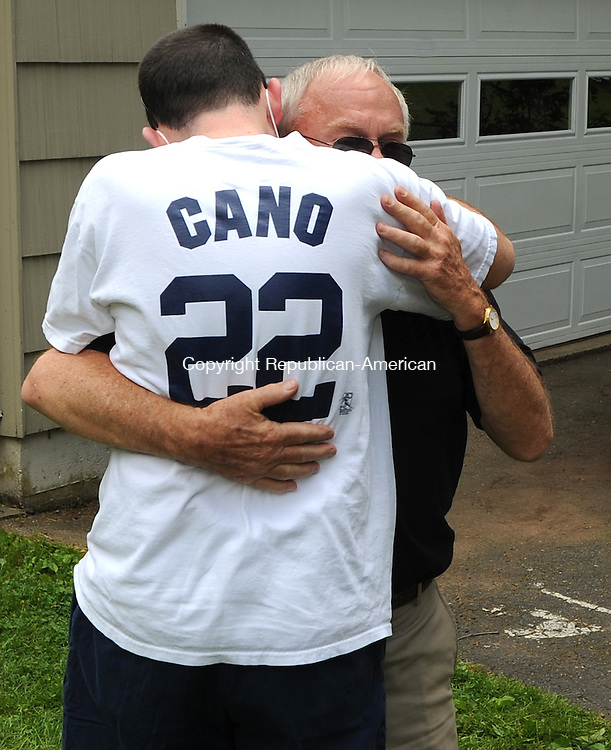 CHESHIRE, CT-10 JUNE 2012--061012JS05-- Colby Salerno, who spent six-months in Hartford Hospital waiting for a heart transplant, gets a hug from his grand-father Bob Sheehan, who is visiting from California, as he returned home to Cheshire on Sunday surrounded by friends, family and supporters. .Jim Shannon Republican-American