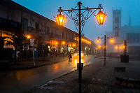 Decorative street lamps are seen shining in the main plaza during the misty nightfall in in Sonsón, a village in the coffee region (Zona cafetera) of Colombia, 22 October 2019.