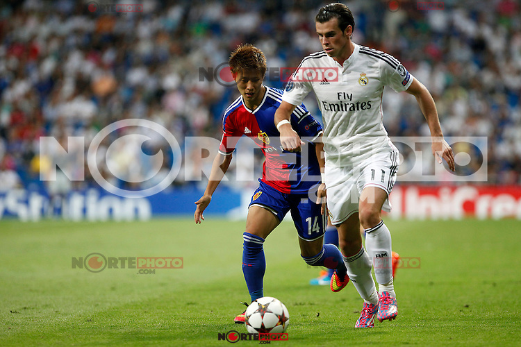 Gareth Bale of Real Madrid and Yoichiro Kakitani of FC Basel 1893 during the Champions League group B soccer match between Real Madrid and FC Basel 1893 at Santiago Bernabeu Stadium in Madrid, Spain. September 16, 2014. (ALTERPHOTOS/Caro Marin) /NortePhoto.com
