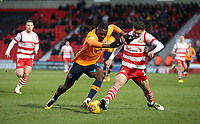 Oldham Athletic's Temitope Obadeyi and Doncaster Rovers' Tyler Garrett during the Sky Bet League 1 match between Doncaster Rovers and Oldham Athletic at the Keepmoat Stadium, Doncaster, England on 16 December 2017. Photo by Juel Miah / PRiME Media Images.