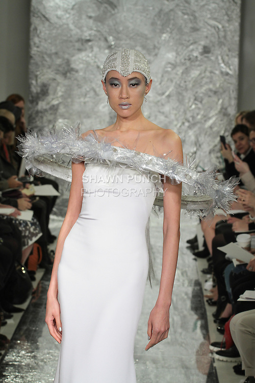 Model Shin Yang walks runway in Rey - a white silk crepe bridal gown with orbiting cosmis floral halo from the Theia Spring 2017 bridal collection by Don O'Neill in collaboration with Miodrag Guberinic, during New York Bridal Fashion Week Spring Summer 2017 on April 14, 2016.