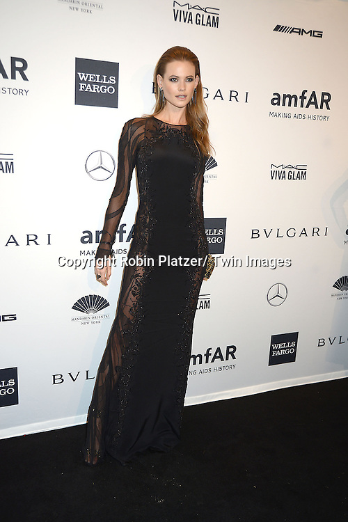 Behati Prinsloo attends the amfAR New York Gala on February 5, 2014 at Cipriani Wall Street in New York City.