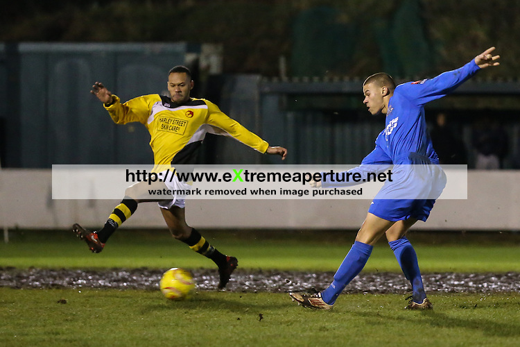 Match action between Redbridge Football Club and Heybridge Swifts Football Club during the Ryman Football League North Division match at Oakside Stadium, Barkingside, Essex IG6 1NB on 5th January 2015<br /> Picture by David Horn/eXtreme Aperture Photography +44 7545 970036<br /> 06/01/2015