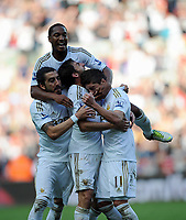 Saturday, 20 October 2012<br /> Pictured: Pablo Hernandez (R) of Swansea celebrating his opening goal with team mates Jonathan de Guzman (TOP) Chico Flores (L) and Angel Rangel (C).<br /> Re: Barclays Premier League, Swansea City FC v Wigan Athletic at the Liberty Stadium, south Wales.