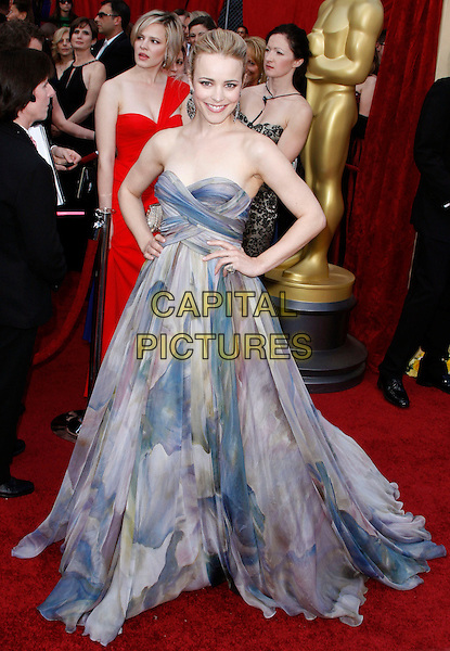 RACHEL McADAMS.The 82nd Annual Academy Awards held aat The Kodak Theatre in Hollywood, California, USA..March 7th, 2010.oscars full length grey gray watercolour watercolor print blue dress hands on hips patterned pattern printed strapless maxi silk gown .CAP/EAST.©Eastman/Capital Pictures.