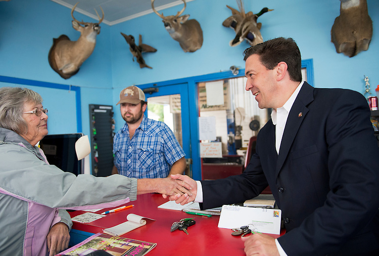 UNITED STATES - MAY 29: Chris McDaniel, Republican candidate for Mississippi Senate, speaks with an employee of Truhitt Service Center in Union, Miss., May 29, 2014. (Photo By Tom Williams/CQ Roll Call)