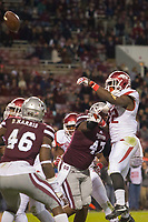NWA Democrat-Gazette/JASON IVESTER<br /> Arkansas running back Rawleigh Williams (22) throws a pass to Arkansas Razorbacks tight end Austin Cantrell (not pictured) for a touchdown against Mississippi State on Saturday, Nov. 19, 2016, at Davis Wade Stadium in Starkville, Miss., during the third quarter.