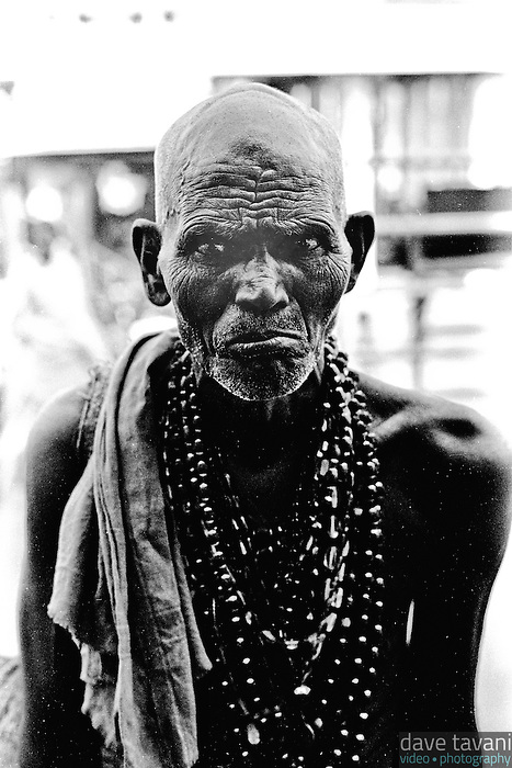 A bead seller stands outside the great temple in Tiruvannamalai, in the Indian state of Tamil Nadu.