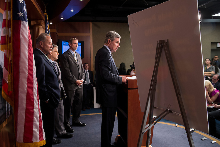 "UNITED STATES - JULY 12: Sen. Sheldon Whitehouse, D-R.I., left, flanked by Sen. Charles Schumer, D-N.Y., Sen. Al Franken, D-Minn., and Sen. Jeff Merkley, D-Ore., speaks during the Senate Democrats' news conference to provide an update on the DISCLOSE Act, legislation to ""shine light on anonymous campaign spending"" on Thursday, July 12, 2012. (Photo By Bill Clark/CQ Roll Call)"