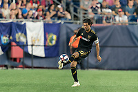 FOXBOROUGH, MA - AUGUST 4: Carlos Vela #10 of Los Angeles FC traps the ball during a game between Los Angeles FC and New England Revolution at Gillette Stadium on August 3, 2019 in Foxborough, Massachusetts.
