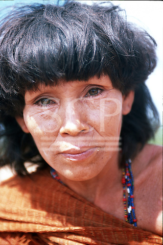 Ipixuna village, Amazon, Brazil. Portrait of a woman wearing traditional home woven fabric wrap; Arawete Indians, Para State.