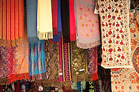 Colorful displays of fabrics hang in the Arab Bazaar in Jerusalem, Israel