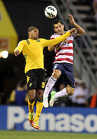 COLUMBUS, OHIO - SEPTEMBER 11, 2012:  Carlos Bocangra (3) of the USA MNT  beats Ryan Johnson (9) of  Jamaica to a header during a CONCACAF 2014 World Cup qualifying  match at Crew Stadium, in Columbus, Ohio on September 11. USA won 1-0.