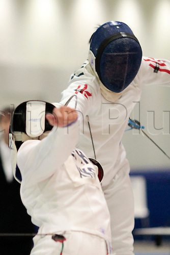 24.02.2011 Cheung Hoi Long of Hong Kong(right) and Lee Tin Hang of Hong Kong(left) compete in the Boys' Epee Individual Finals of the Cadet Fencing World Cup, Republic Polytechnic, Singapore.