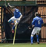 Steven Maclean celebrates his goal for St Johnstone by kicking the corner flag